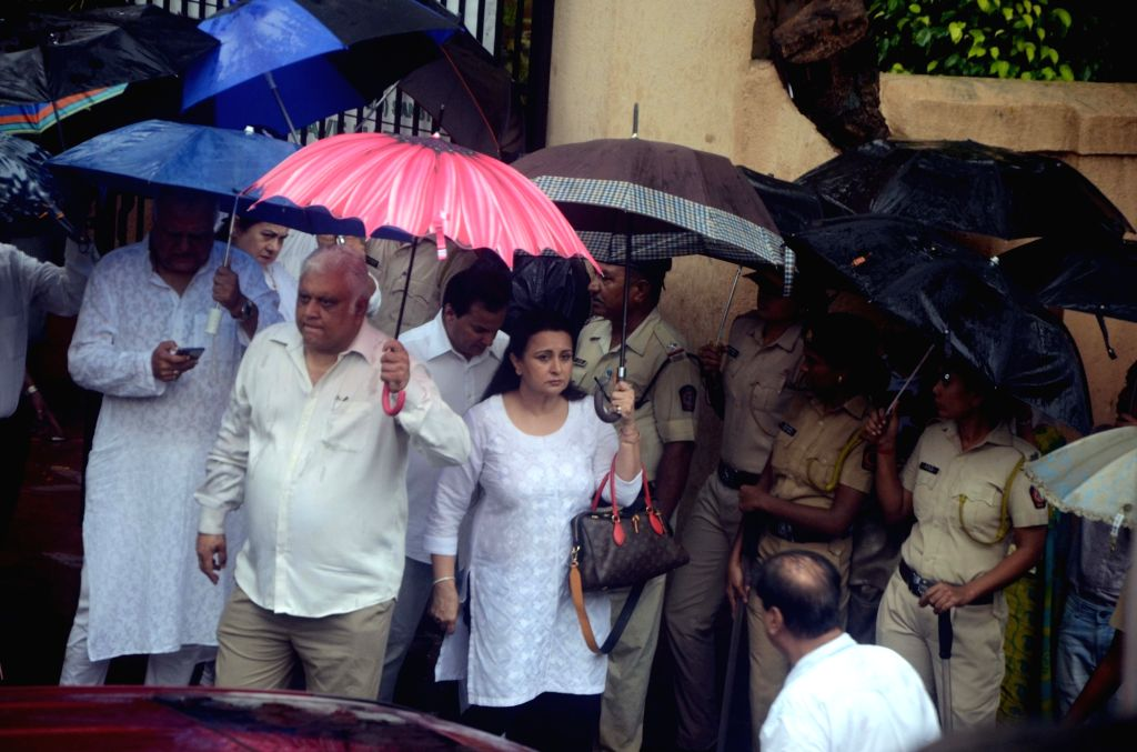 Actress Poonam Dhillon attends the funeral of late actor-filmmaker Shashi Kapoor in Mumbai on Dec 5, 2017. The romantic screen icon of the 1970s and early 1980s died aged 79. The cause of ... - Poonam Dhillon and Shashi Kapoor