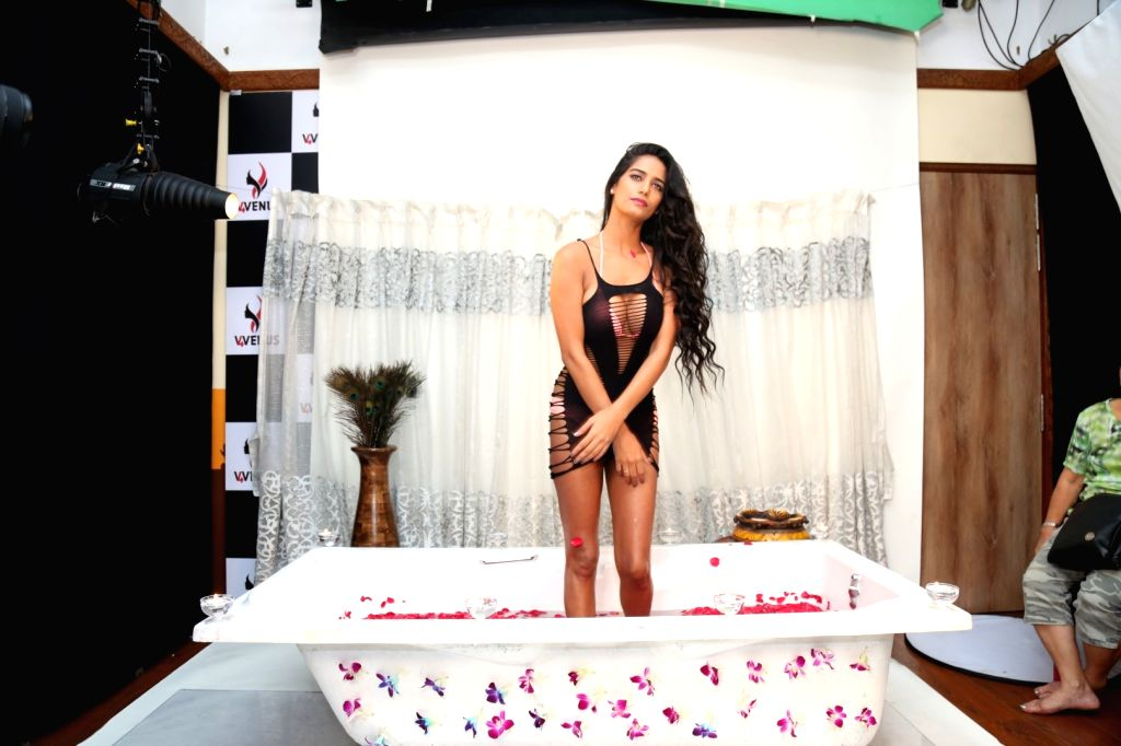 Actress Poonam Pandey during a personal photo shoot in Mumbai India on Sep 20, 2016. - Poonam Pandey