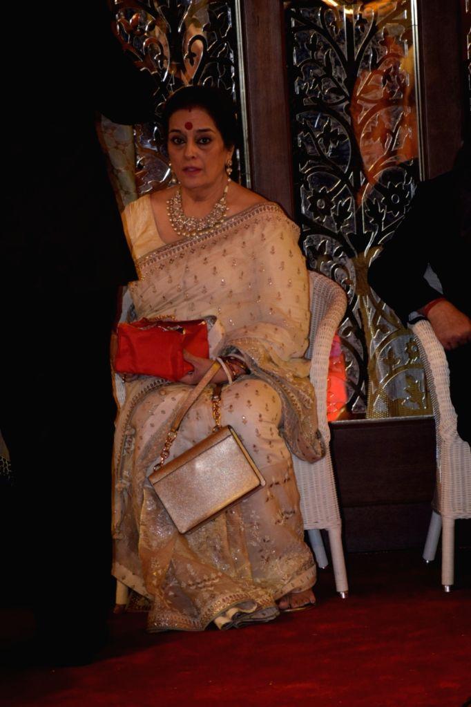 Actress Poonam Sinha at the wedding ceremony of industrialist Mukesh Ambani's daughter Isha Ambani and Anand Piramal at Antilia in Mumbai on Dec 12, 2018. - Poonam Sinha, Mukesh Ambani and Isha Ambani