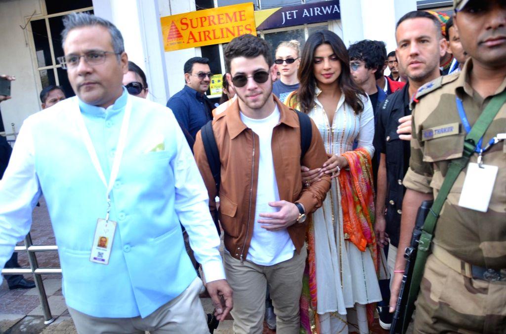 Actress Priyanka Chopra and American singer Nick Jones arrives at Jodhpur Airport on Nov. 29, 2018. - Priyanka Chopra