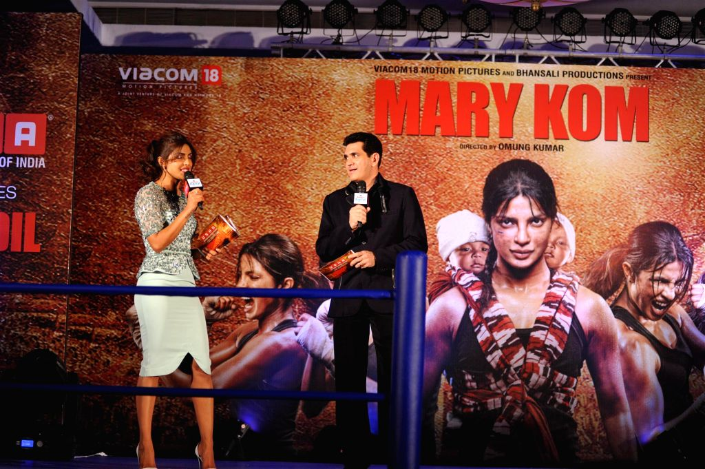 Actress Priyanka Chopra and filmmaker Omung Kumar during the music launch of film Mary Kom in Mumbai on August 13, 2014. - Priyanka Chopra and Omung Kumar