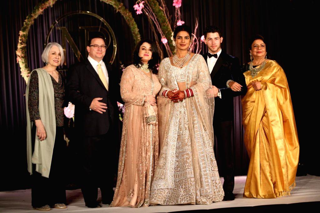 Actress Priyanka Chopra and her husband American singer Nick Jonas at their wedding reception in New Delhi on Dec 4, 2018. Also seen Nick's parents Denise Miller-Jonas and Paul Kevin ... - Priyanka Chopra and Madhu Chopra