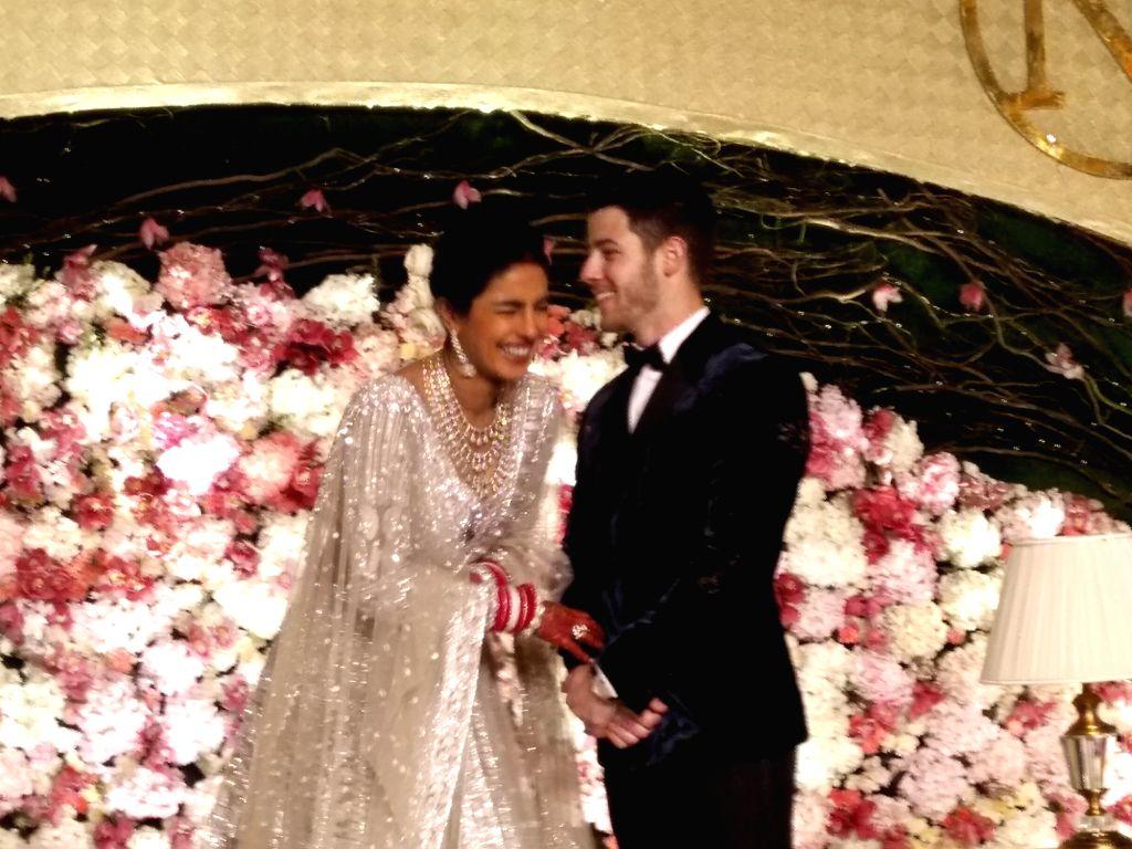 Actress Priyanka Chopra and her husband American singer Nick Jonas at their wedding reception in New Delhi on Dec 4, 2018. - Priyanka Chopra