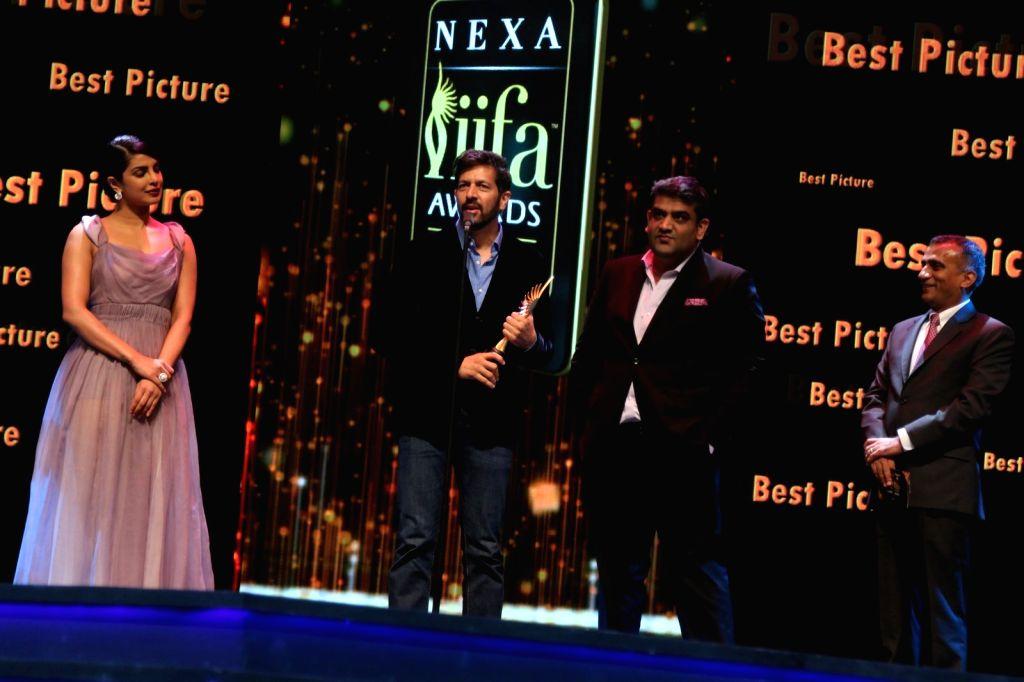 Actress  Priyanka Chopra, Kabir Khan during IIFA Awards in Madrid on June 26, 2016. - Priyanka Chopra and Kabir Khan