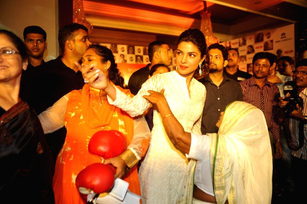 Actress Priyanka Chopra promoting Mary Kom with Tata salt campaign 'Maine Desh ka Namak Khaya Hai' reciting 'The Tale of India' inspiring heroes in Mumbai on Sept 10, 2014.