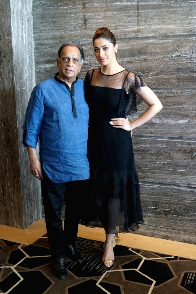 """Actress Raai Laxmi and Former chief of the Central Board of Film Certification  Pahlaj Nihalani during the interview for upcoming film """"Julie 2"""" in Mumbai on Sept 26, 2017. - Raai Laxmi"""