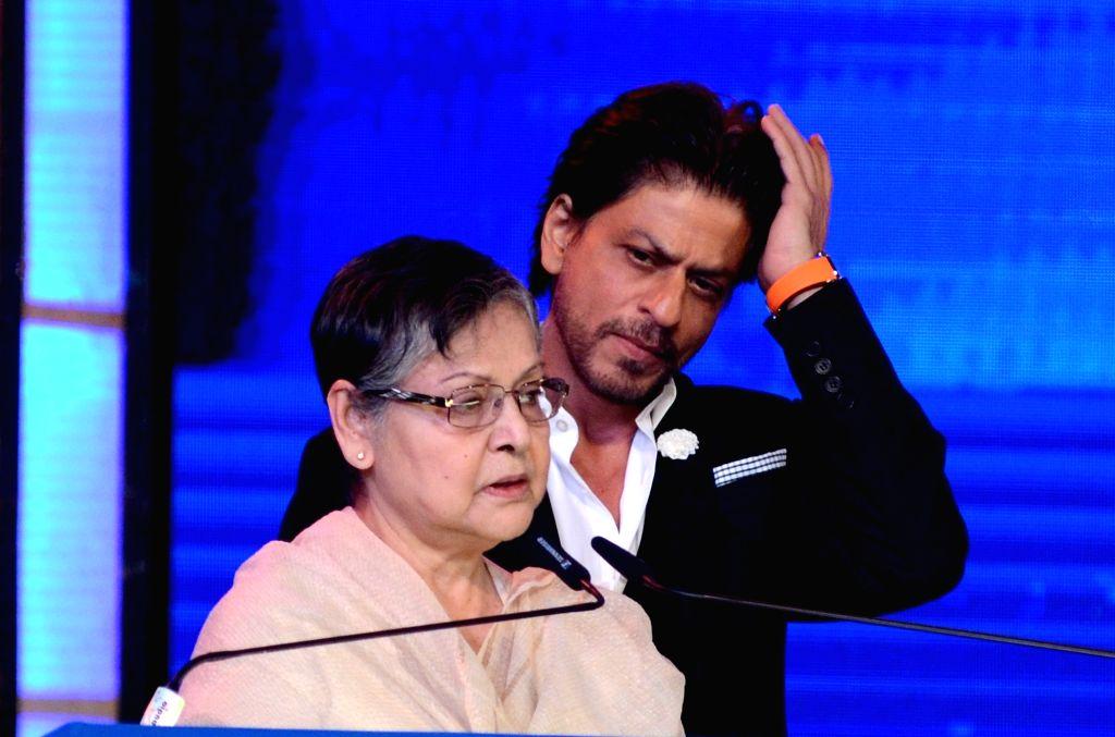 Actress Rakhee Gulzar accompanied by actor Shah Rukh Khan, addresses at the inaugural session of 25th Kolkata International Film festival, in Kolkata on Nov 8, 2019. - Rakhee Gulzar and Rukh Khan