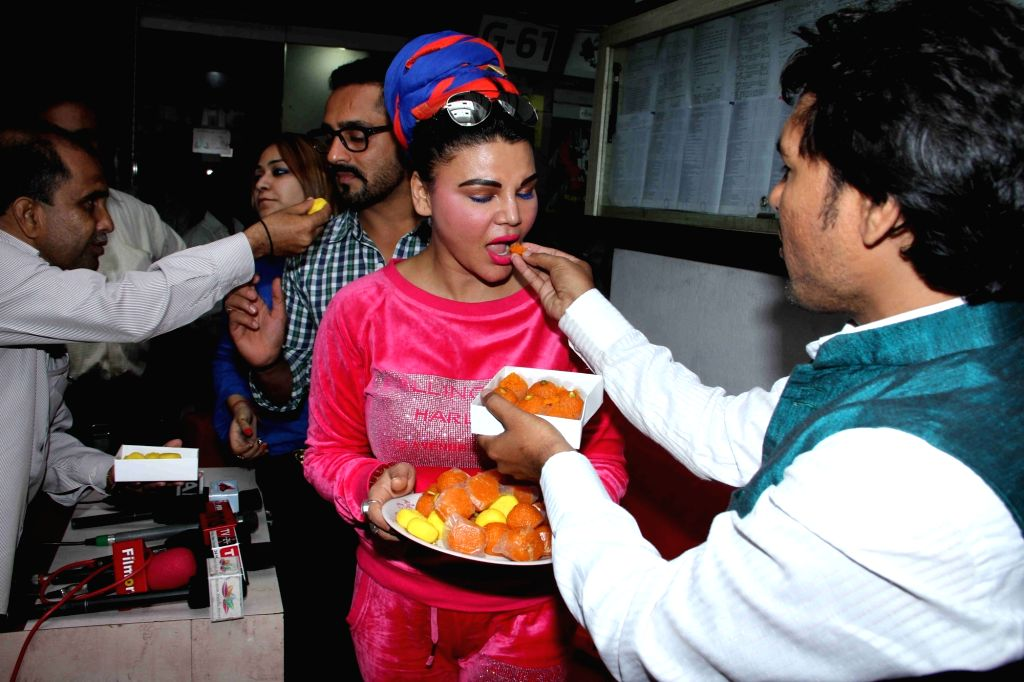 Actress Rakhi Sawant along with Republican Party of India (Athawale) party worker celebrates after the RPI (Athawale) leader Ramdas Athawale inducted in the Modi government in Mumbai, on June ... - Rakhi Sawant