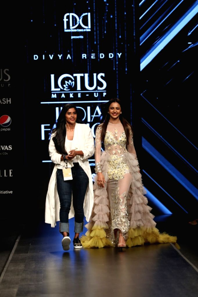 Actress Rakul Preet Singh and fashion designer Divya Reddy on the third day of Lotus Make-up India Fashion Week, in New Delhi on Oct 11, 2019. - Rakul Preet Singh and Divya Reddy