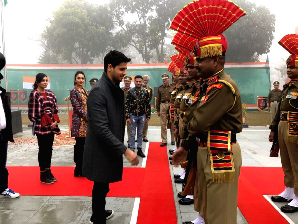 Actress Rakul Preet Singh shakes hands with soldiers on Republic Day at BSF Khasa camp near  Amritsar  in Punjab, on Jan 26, 2018. - Rakul Preet Singh