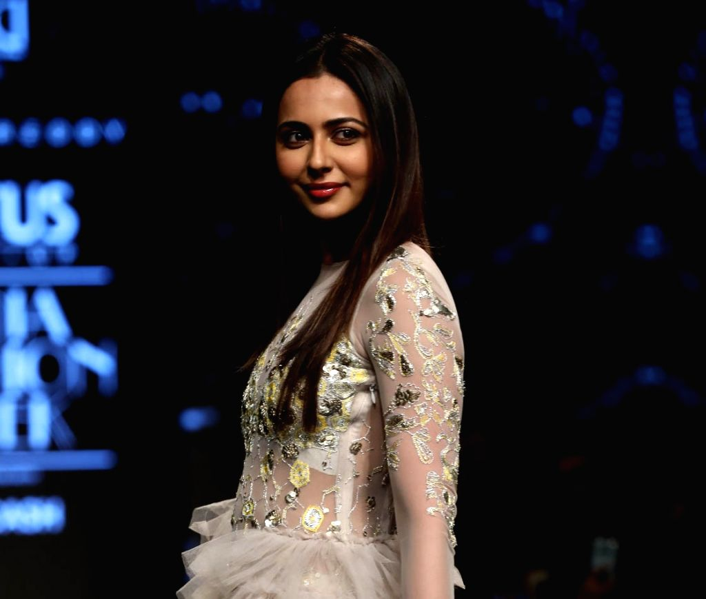 Actress Rakul Preet Singh showcases the creation of fashion designer Divya Reddy on the third day of Lotus Make-up India Fashion Week, in New Delhi on Oct 11, 2019. - Rakul Preet Singh and Divya Reddy