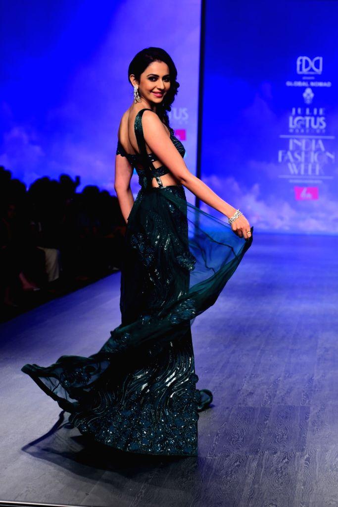 Actress Rakul Preet Singh walks the ramp showcasing fashion designer Julie Shah's creation on the second day of Lotus India Fashion Week in New Delhi, on March 14, 2019. - Rakul Preet Singh and Julie Shah