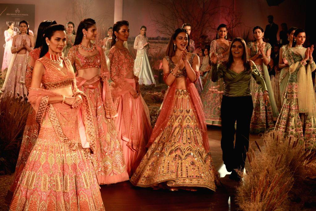 Actress Rakul Preet Singh with fashion designer Reynu Tandon at the India Couture Week 2019 in New Delhi, on July 26, 2019. - Rakul Preet Singh