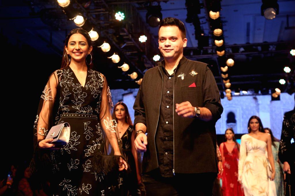Actress Rakul Preet Singh with fashion designer Nachiket Barve at the Lakme Fashion Week Winter/Festive 2019 in Mumbai on Aug 23, 2019. - Rakul Preet Singh