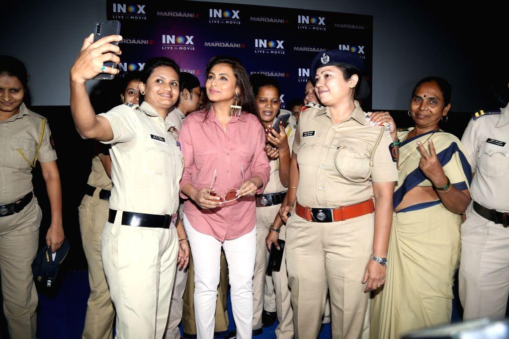 "Actress Rani Mukerjee poses for selfies with women police personnel at the screening of her upcoming film ""Mardaani 2"", in Mumbai on Dec 11, 2019. - Rani Mukerjee"