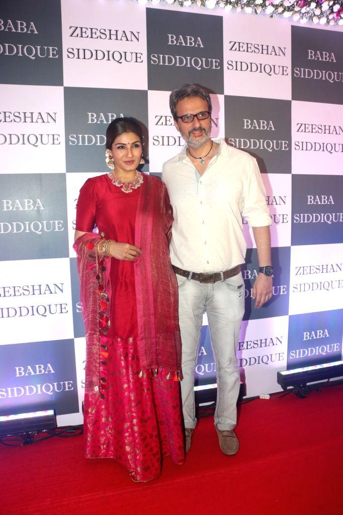 Actress Raveena Tandon and her husband Anil Thadani at Congress leader Baba Siddique's Iftar party in Mumbai, on June 2, 2019. - Raveena Tandon