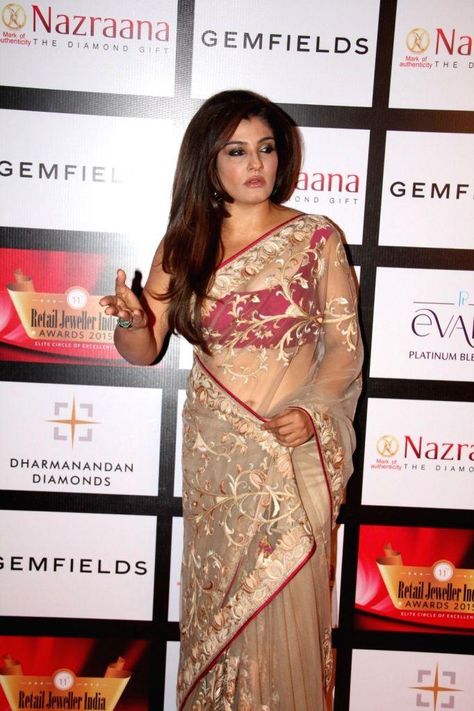 Actress Raveena Tandon during the Gemfields and Nazraana Retail Jeweller India Awards 2015, in Mumbai on Aug 8, 2015. - Raveena Tandon