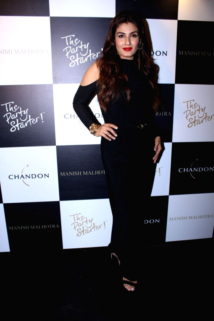 Actress Raveena Tandon during the launch of Manish Malhotra X Chandon Champagne bottles Limited Edition End Of Year 2017 in Mumbai on Oct 9, 2017. - Raveena Tandon