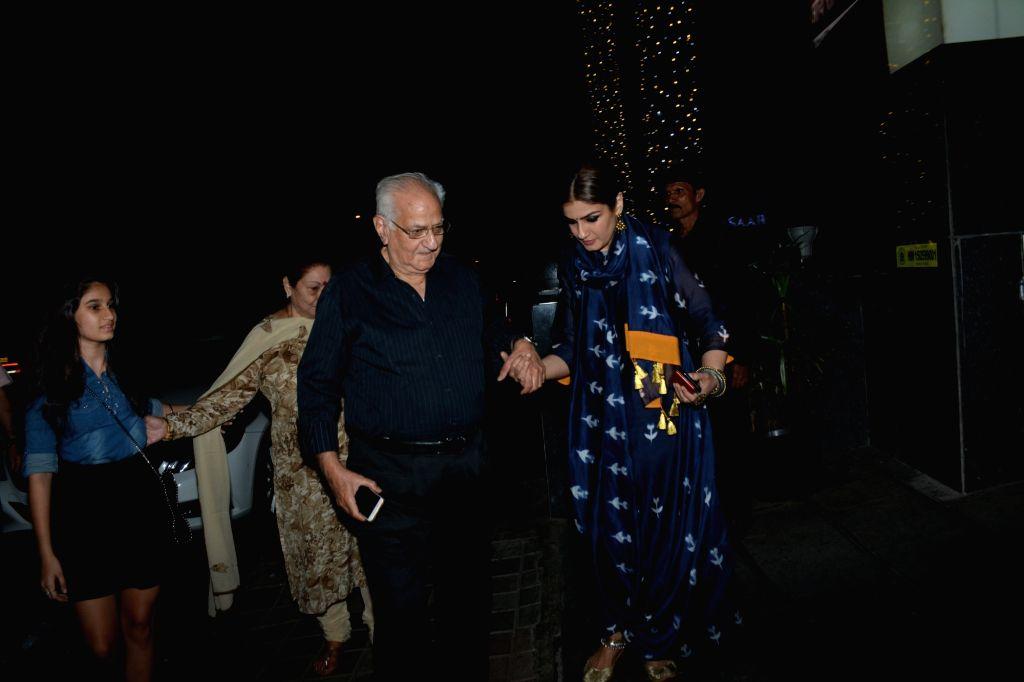 Actress Raveena Tandon with her family seen at Mumbai's Bandra, on Feb 16, 2019. - Raveena Tandon