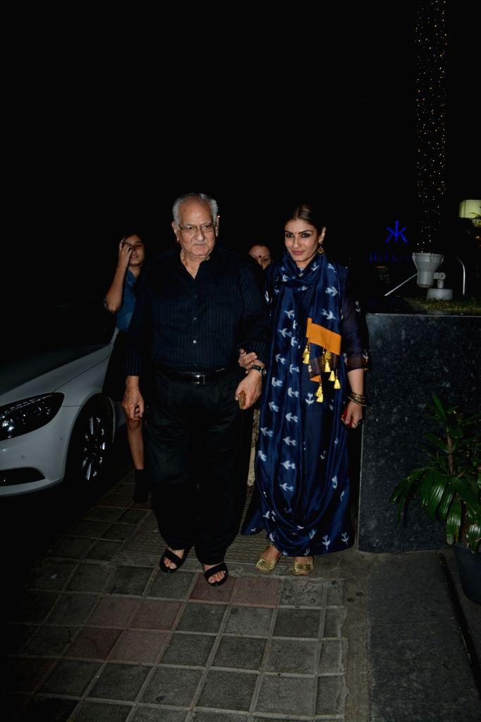 Actress Raveena Tandon with her father Ravi Tandon seen at Mumbai's Bandra, on Feb 16, 2019. - Raveena Tandon