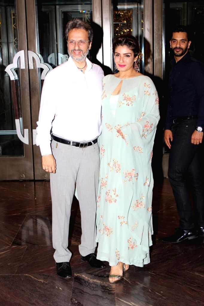 Actress Raveena Tandon with her husband Anil Thadani arrives to attend the engagement ceremony of Zaheer Khan and Sagarika Ghatge, in Mumbai, on May 23, 2017. - Raveena Tandon and Zaheer Khan