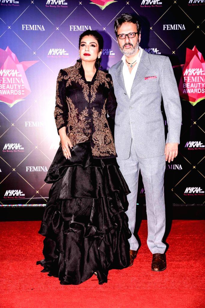 Actress Raveena Tandon with her husband Anil Thadani at Nykaa Femina Beauty Awards 2019, in Mumbai, on Feb 20, 2019. - Raveena Tandon