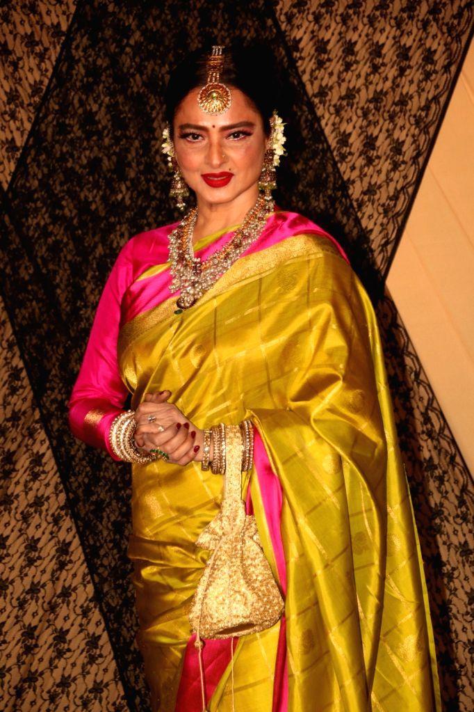 Actress Rekha at the wedding reception of director Mukesh Bhatt and Nilima Bhatt's daughter Sakshi Bhatt in Mumbai, on 25, 2019. - Rekha
