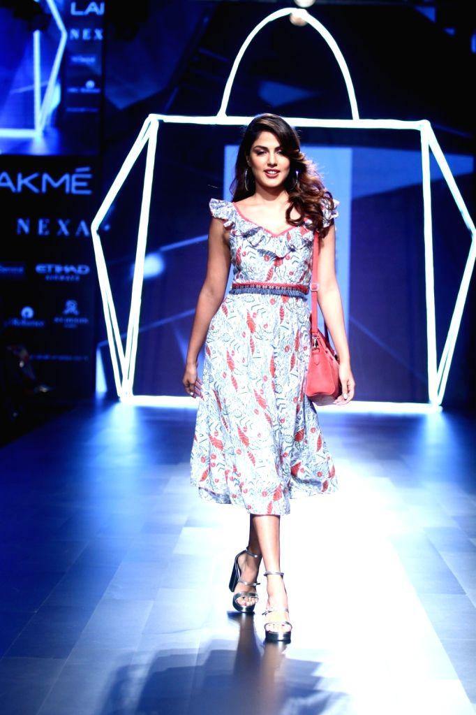 Actress Rhea Chakraborty displays the creation of fashion designer Karuna during the Lakme Fashion Week Winter/Festive 2017 in Mumbai on Aug 18, 2017. - Rhea Chakraborty