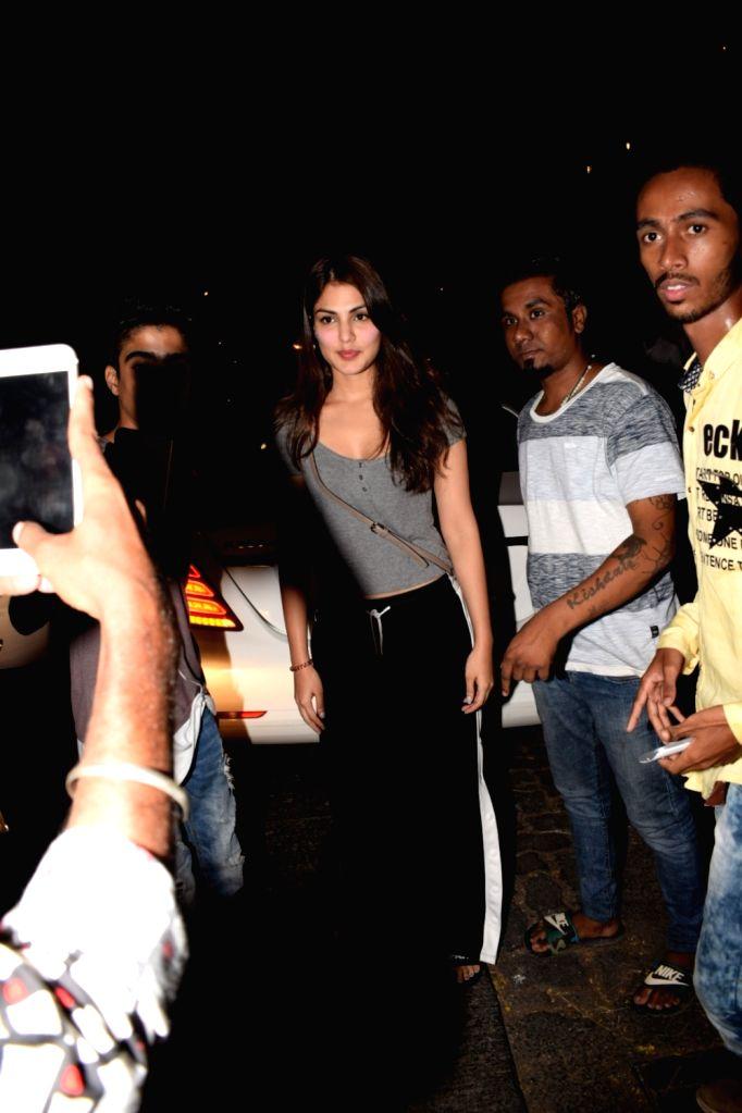 Actress Rhea Chakraborty seen at Chhatrapati Shivaji Maharaj International airport in Mumbai on Nov 29, 2017. - Rhea Chakraborty