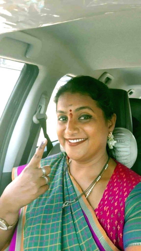 Actress Roja shows her inked finger after casting her vote for the 2019 Lok Sabha elections in Hyderabad, on April 11, 2019. - Roja