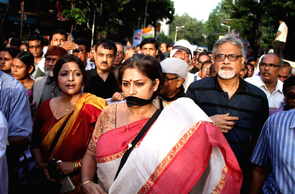 Actress Roopa Ganguly and other intellectuals participate in demonstration against West Bengal Chief Minister Mamata Banerjee in Kolkata, on Aug 14, 2015. - Roopa Ganguly and Mamata Banerjee