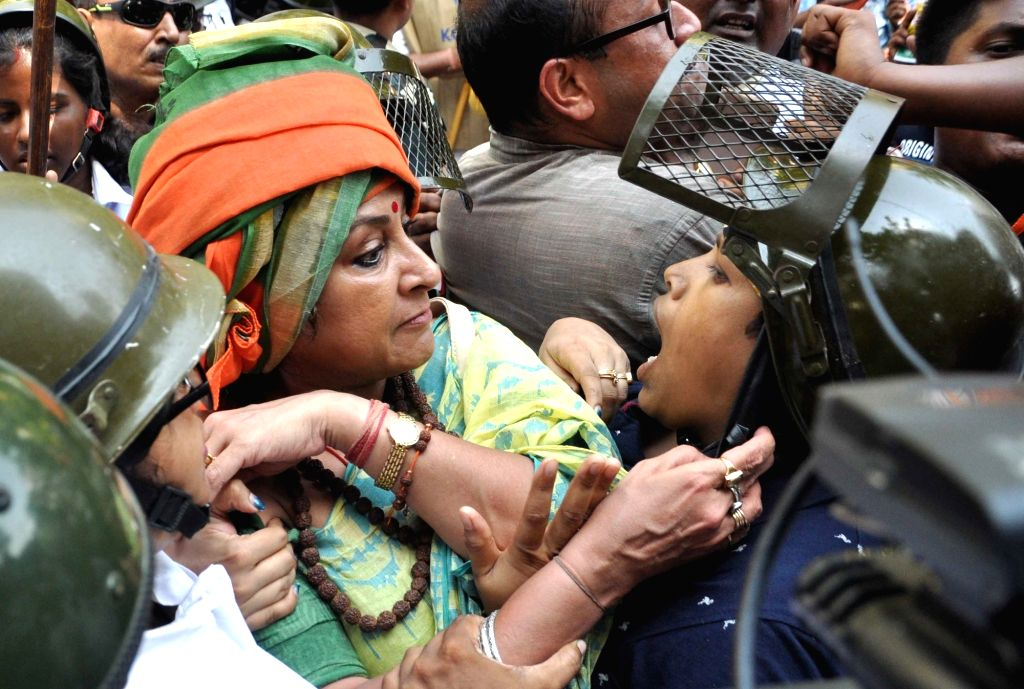 Actress Roopa Ganguly during a protest against the law and order situation in West Bengal and fake cases lodged against their party workers among other issues in Lalbazar of Kolkata on May ... - Roopa Ganguly