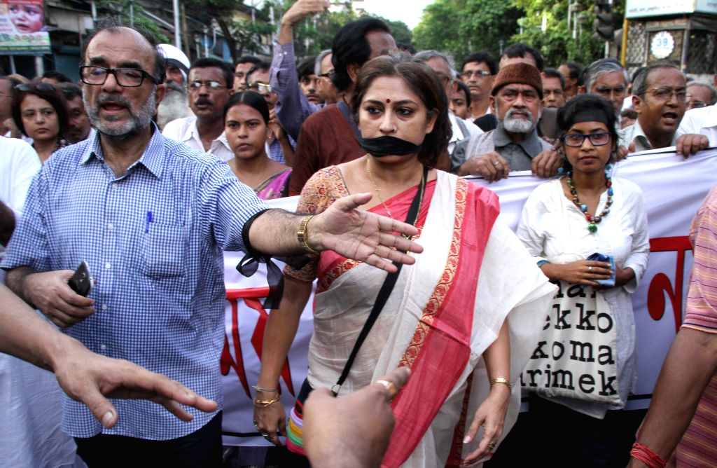 Actress Roopa Ganguly, former Kolkata Mayor Bikash Ranjan Bhattacharya and other intellectuals participate in demonstration against West Bengal Chief Minister Mamata Banerjee in Kolkata, on ... - Roopa Ganguly and Mamata Banerjee