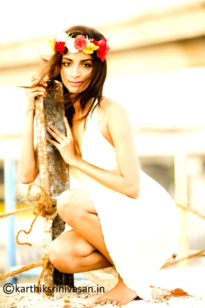Actress Sahithya poses  for a photograph during a photoshoot.