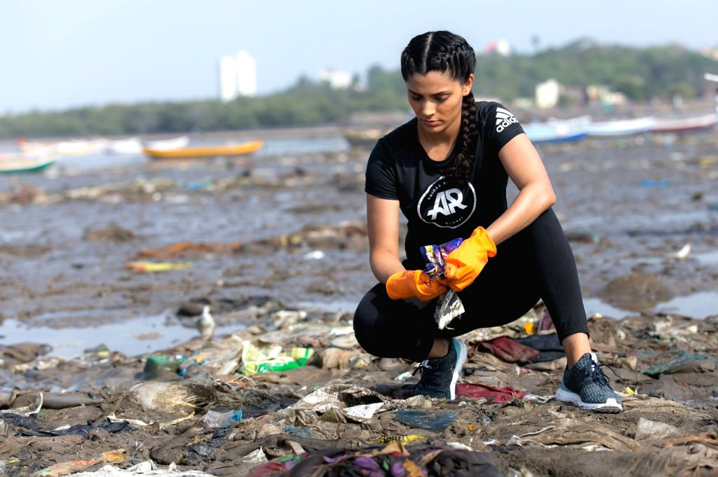 Actress Saiyami Kher participate in the Adidas beach cleaning movement at Versova Jetty Beach in Mumbai's Juhu on May 20, 2018. - Saiyami Kher