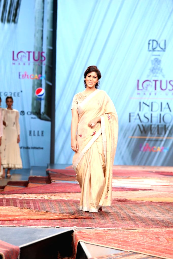 Actress Sakshi Tanwar walks the ramp showcasing the collection from fashion designer Pratima Pandey's fashion label Prama on the first day of Lotus India Fashion Week, in New Delhi on Oct ... - Sakshi Tanwar and Pratima Pandey