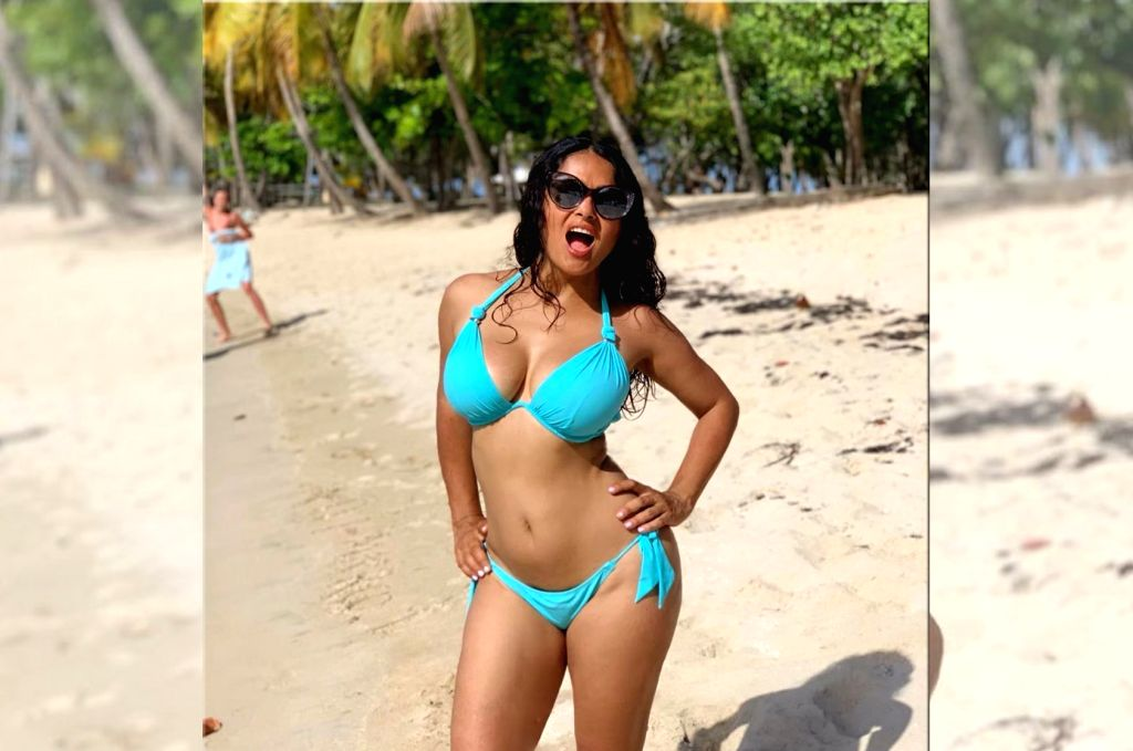 """Actress Salma Hayek found a sexy way to celebrate her 53rd birthday, by flaunting a bikini body on social media.  """"Yes, tomorrow I'm 53. So?!"""" she captioned an image she posted on Instagram, which shows her in a blue bikini on the beach. - Salma Hayek"""