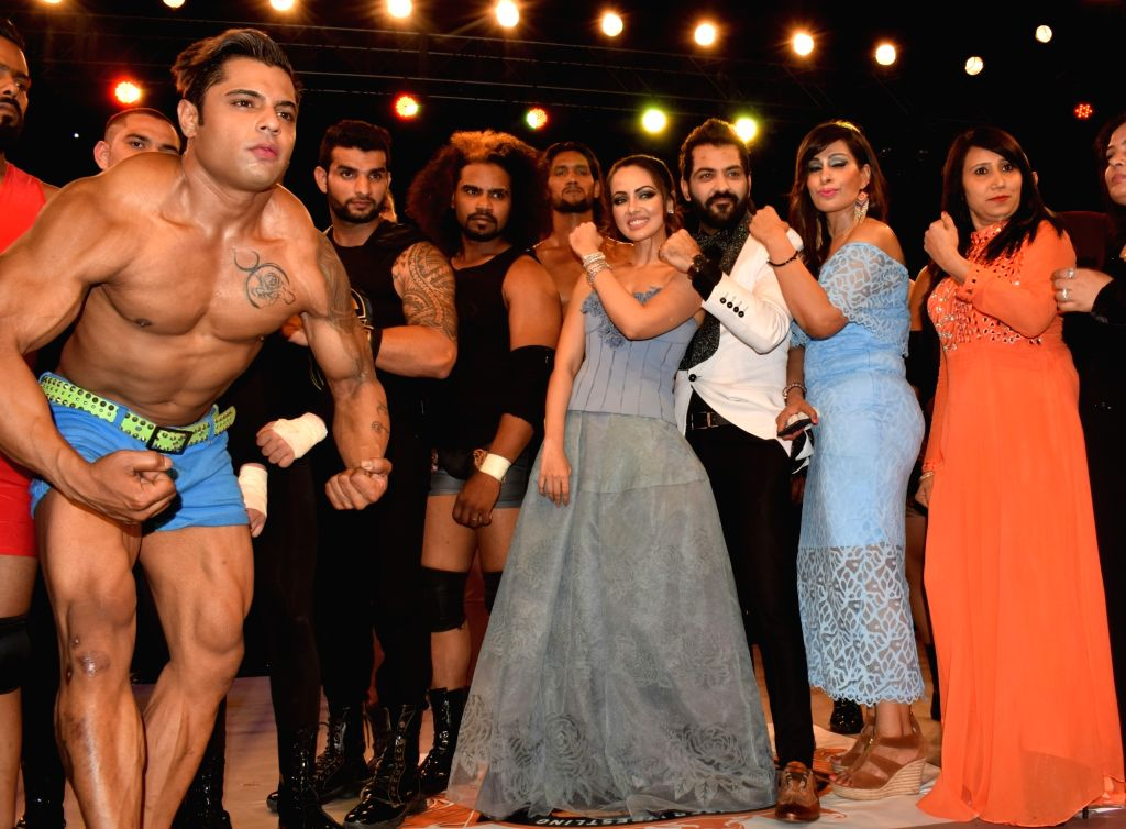 """Actress Sana Khan along with Big Boss 10 contestant Manu Punjabi during the launch of """"The Unique War"""" - a wrestling series in New Delhi on Aug 18, 2017. - Sana Khan"""