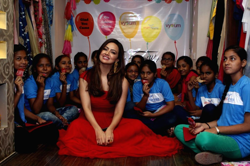 Actress Sana Khan with children during the inauguration of shop for cause by Vyoum, a designer store in association with Angel Xpress foundation in Mumbai on May 5, 2017. - Sana Khan