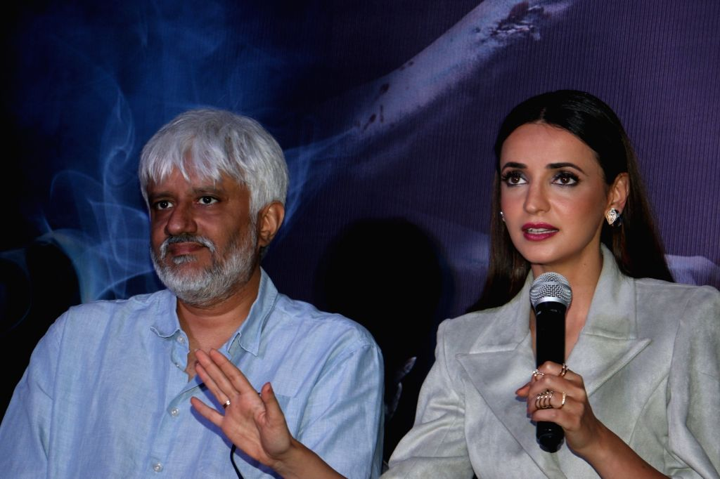 """Actress Sanaya Irani accompanied by director Vikram Bhatt, addresses at a press conference during the promotions of their upcoming film """"Ghost"""" in Mumbai on Oct 15, 2019. - Sanaya Irani"""