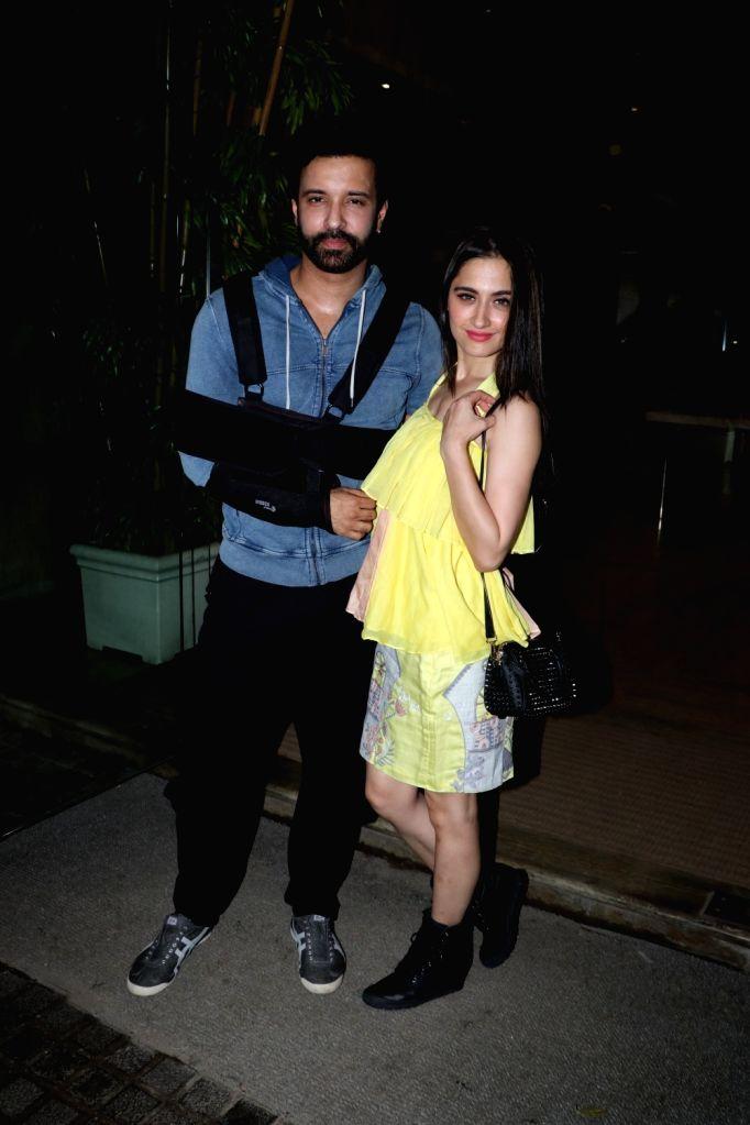"""Actress Sanjeeda Sheikh with husband Aamir Ali during the screening of upcoming film """"Ashke"""", in Mumbai on July 28, 2018. - Sanjeeda Sheikh"""