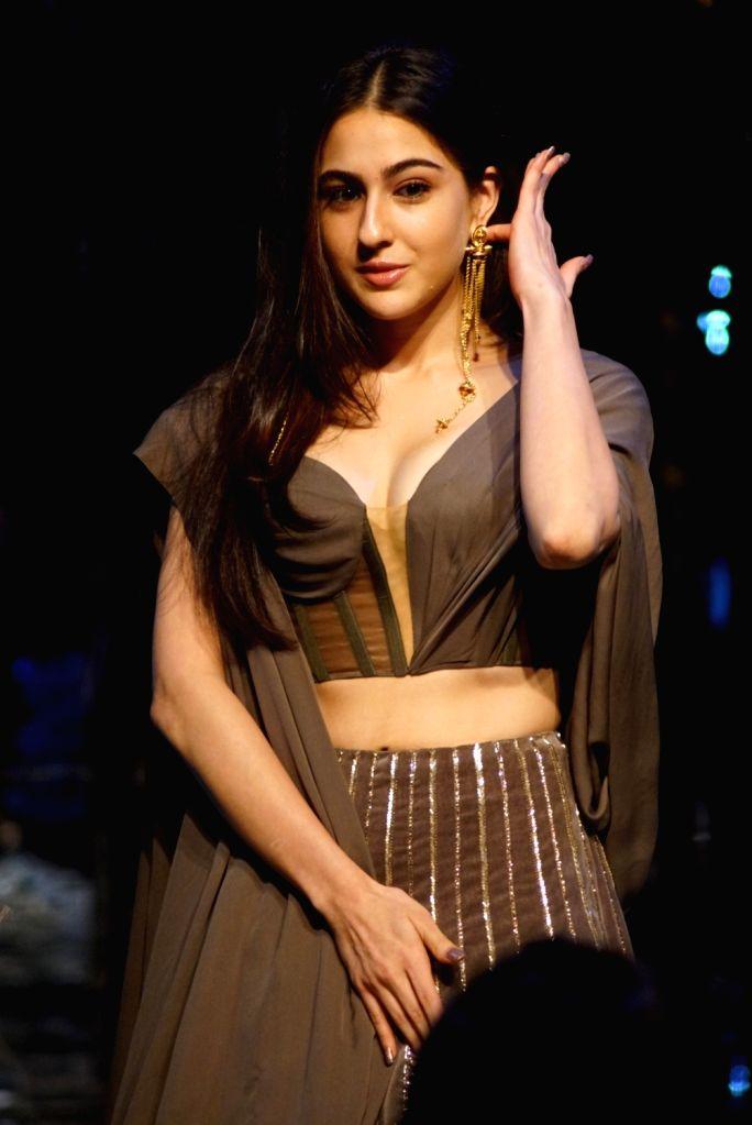 Actress Sara Ali Khan at fashion designer Manish Malhotra's haute couture show, in Mumbai on Aug 1, 2018. - Sara Ali Khan and Manish Malhotra