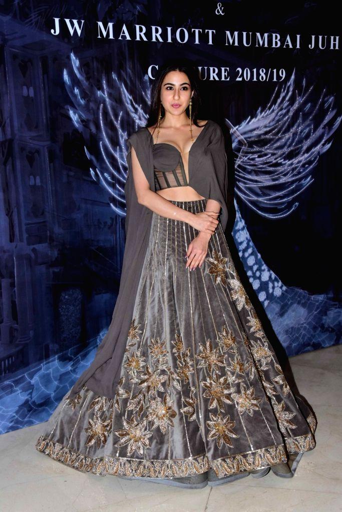 Actress Sara Ali Khan at the fashion designer Manish Malhotra's Haute Couture 2018 in Mumbai. - Sara Ali Khan and Manish Malhotra