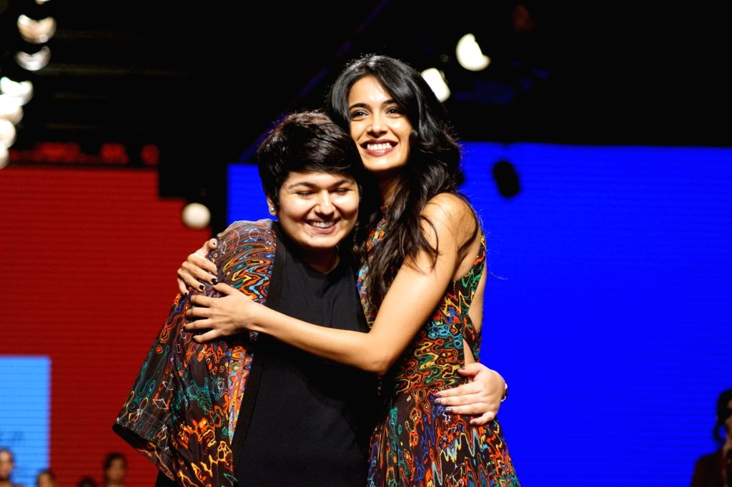Actress Sarah-Jane Dias displays the creation of fashion designer Urvashi Joneja during the Lakme Fashion Week Winter/Festive 2017 in Mumbai on Aug 18, 2017. - Sarah-Jane Dias