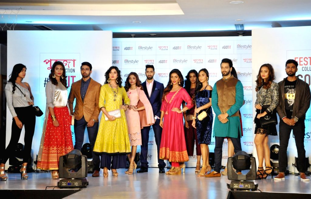 Actress Sayantika Banerjee along with models during the launch of the festive collection of a fashion brand ahead of Durga Puja, in Kolkata on Sept 11, 2018. - Sayantika Banerjee