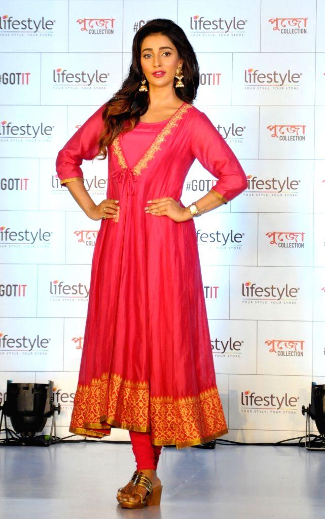 Actress Sayantika Banerjee walks the ramp during the launch of the festive collection of a fashion brand ahead of Durga Puja, in Kolkata on Sept 11, 2018. - Sayantika Banerjee