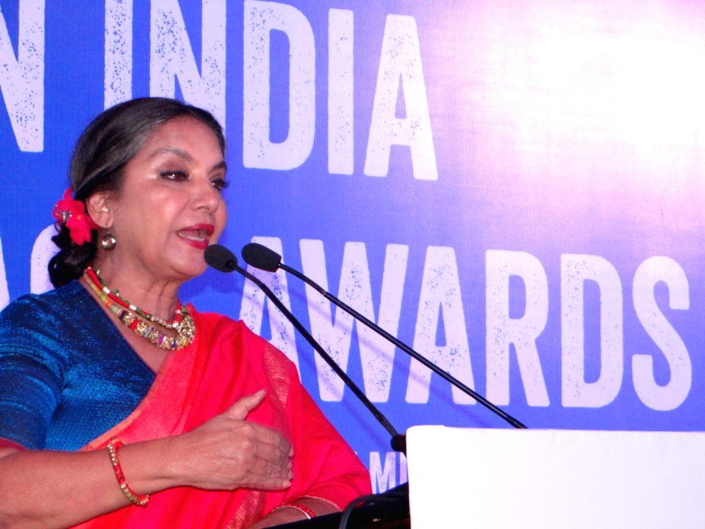 Actress Shabana Azmi addresses during Plan India Impact Awards 2018, in New Delhi on July 27, 2018. - Shabana Azmi