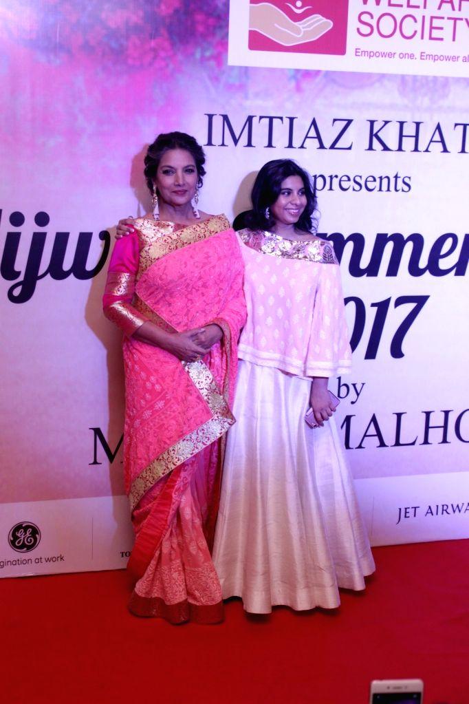 Actress Shabana Azmi and Namrata Goyal during the Mijwan Summer 2017 fashion show during the Mijwan Summer 2017 fashion show in Mumbai on March 5, 2017. - Shabana Azmi