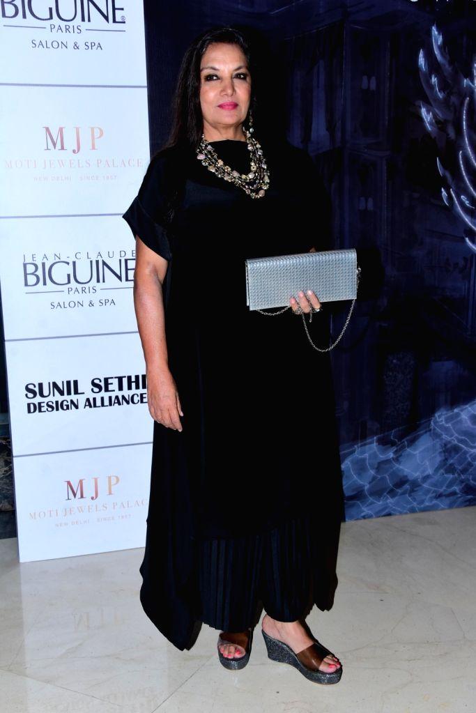 Actress Shabana Azmi at the fashion designer Manish Malhotra's Haute Couture 2018 in Mumbai. - Shabana Azmi and Manish Malhotra