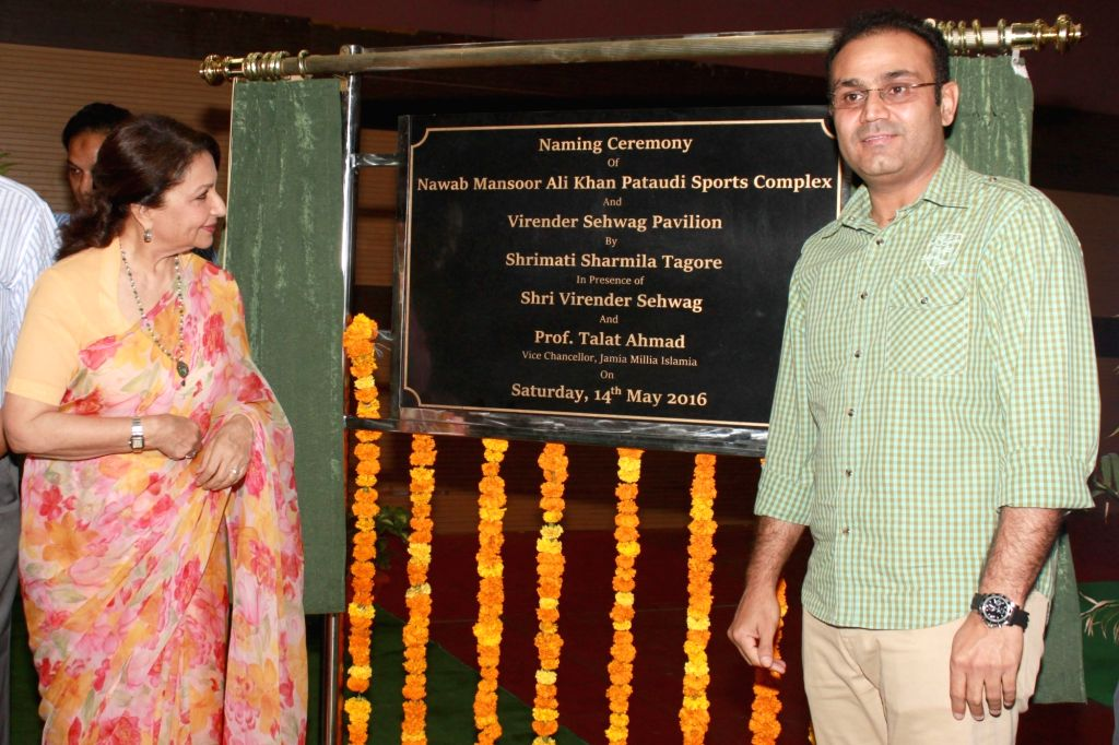 Actress Sharmila Tagore and former India cricketer Virender Sehwag during the unveil of Nawab Mansoor Ali Khan Pataudi Complex and Virender Sehwag Pavilion at Jamia Millia Islamia, in New ... - Sharmila Tagore